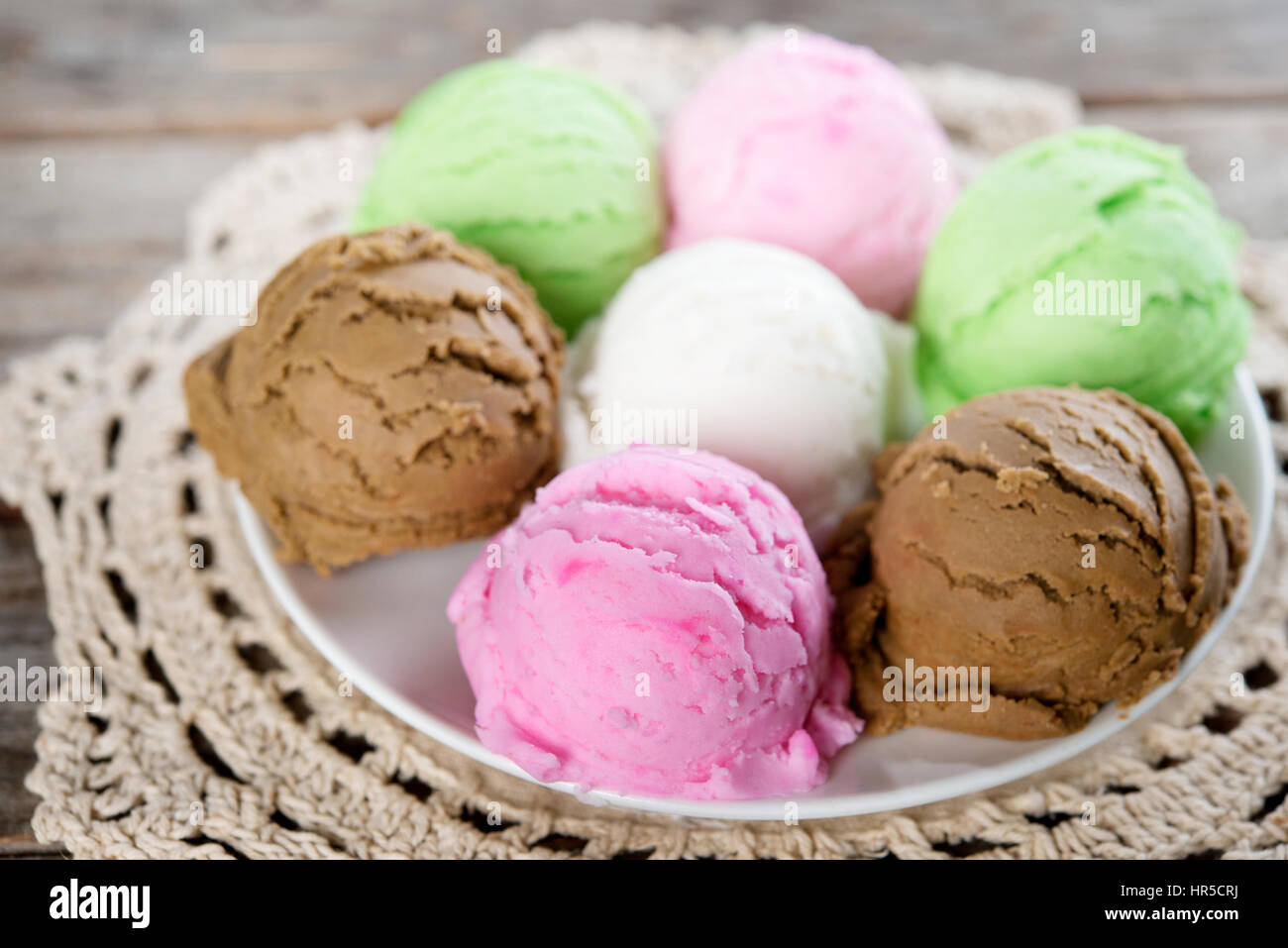 Close up assorted ice cream scoops on brown wooden background Stock ...