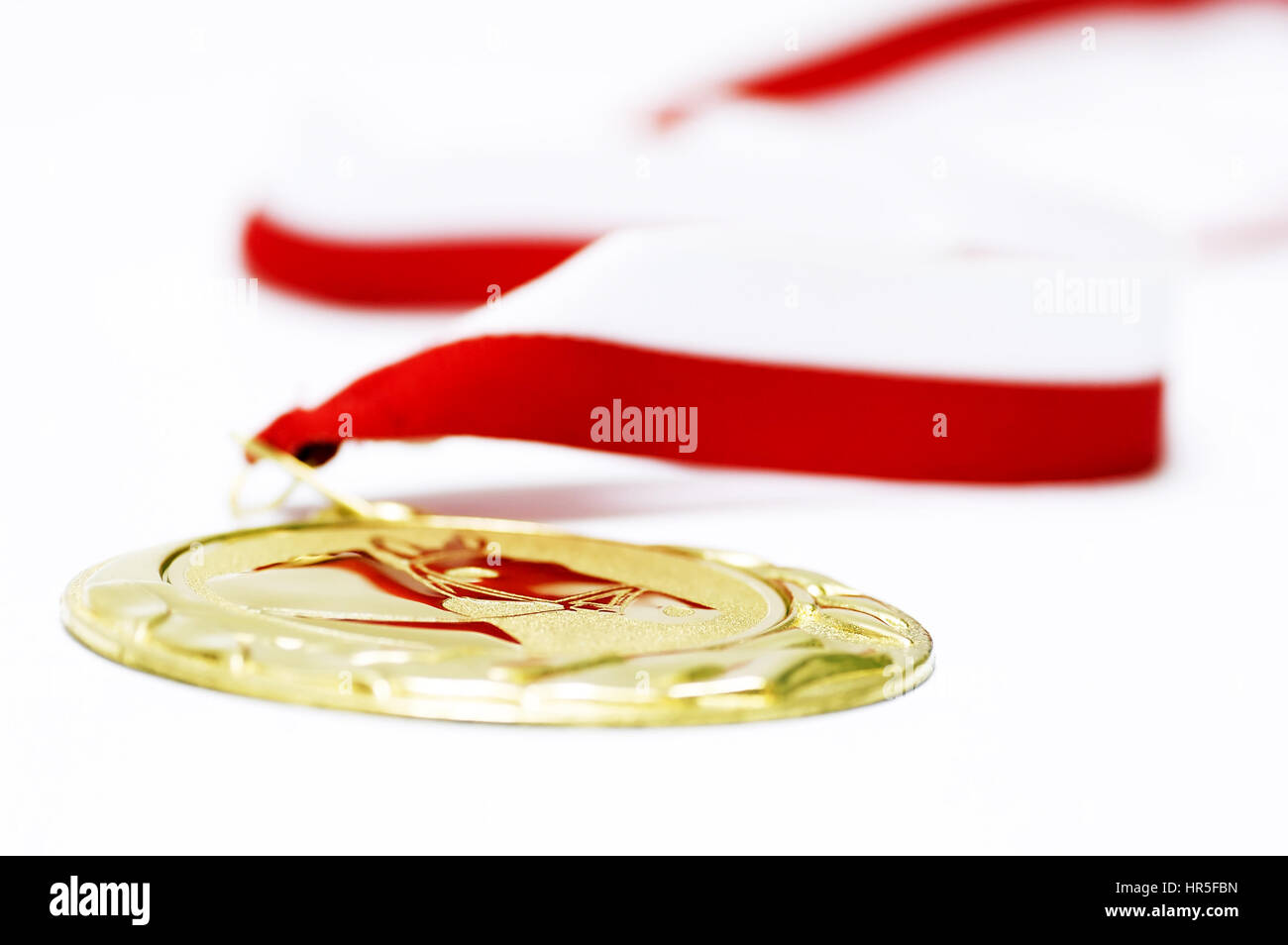 gold medal, as symbol of victory and success - Stock Image