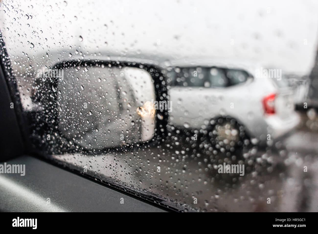 Raindrops on the car rearview mirror  Heavy rain outside