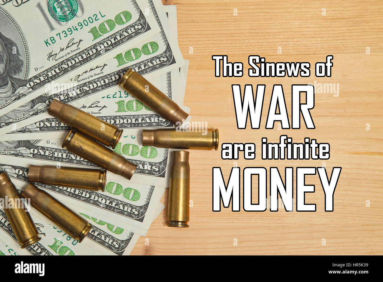 Bullet shells and dollars with message 'The Sinews of War are infinite Money' - Stock Image