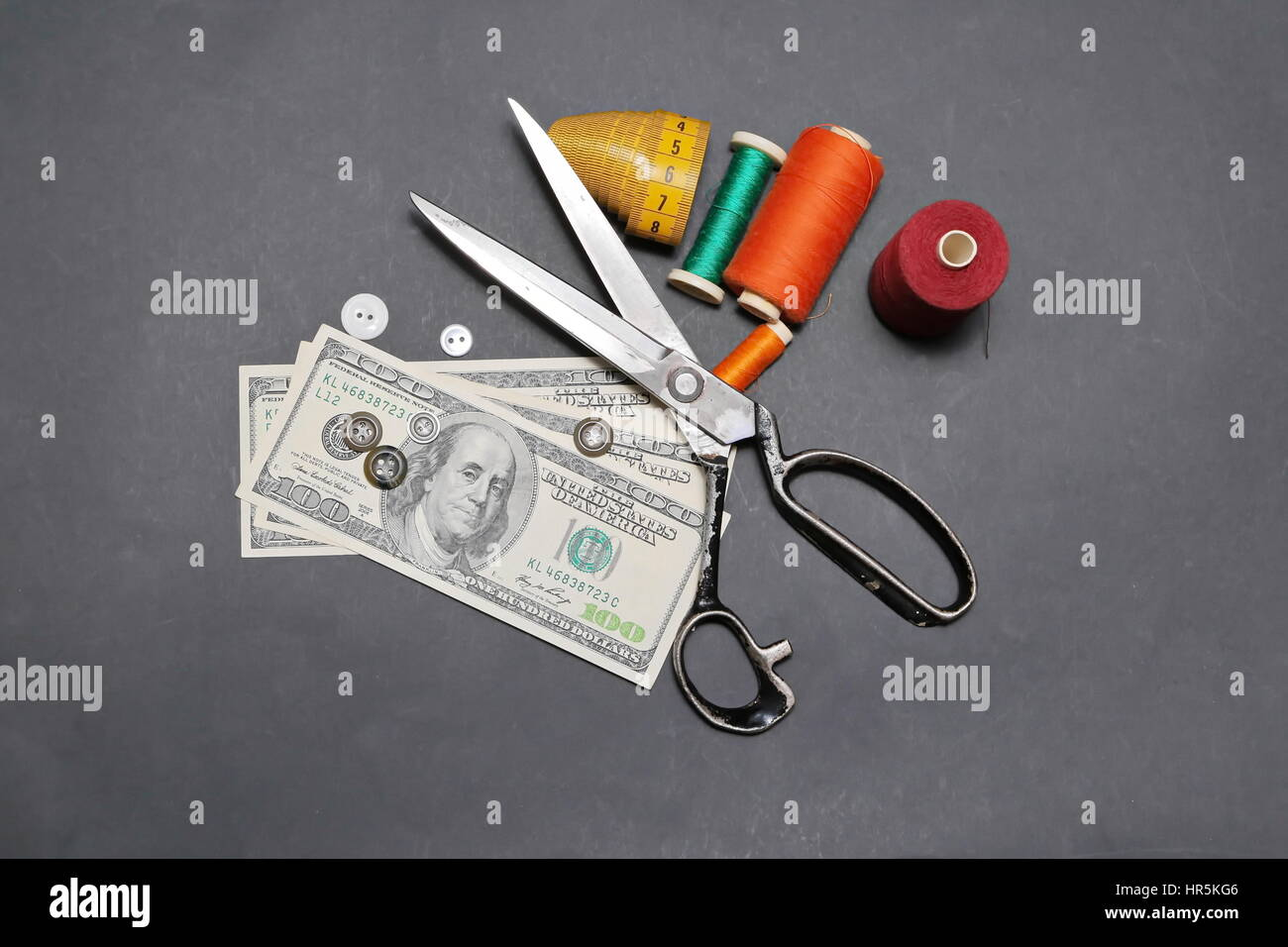 Can you make money sewing. American dollars and  accessories for cutting and sewing - Stock Image