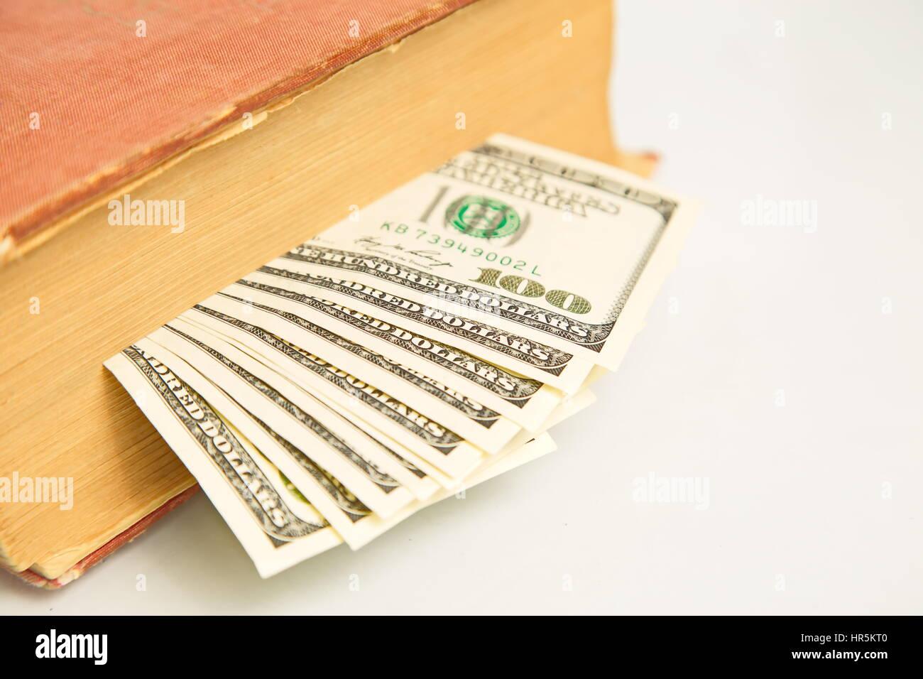 Hundred dollar bills in book - Stock Image