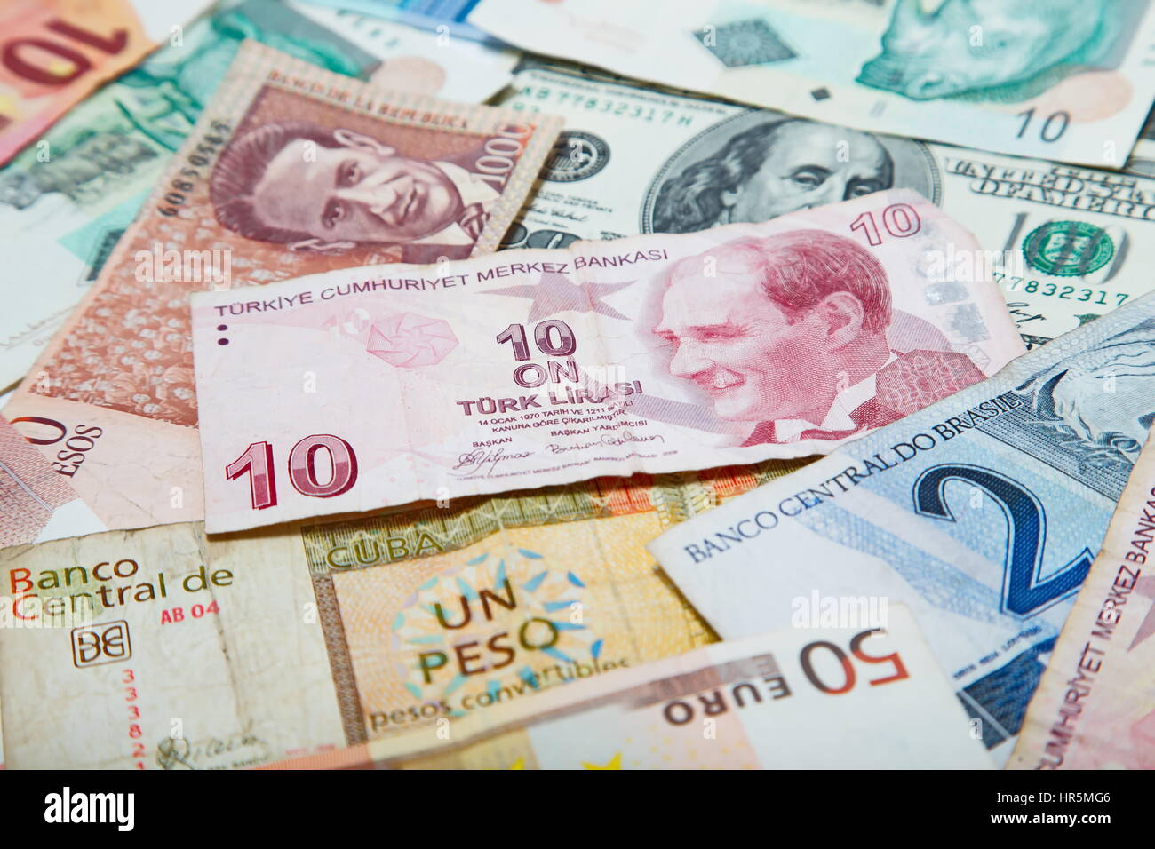 Background from paper money of the different countries. Turkish lira in the middle Stock Photo