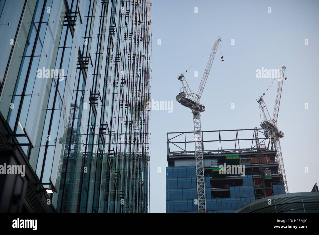Tower Cranes working what was Quay House in Spinningfiled,  The Avenue, Manchester, England,UK - Stock Image