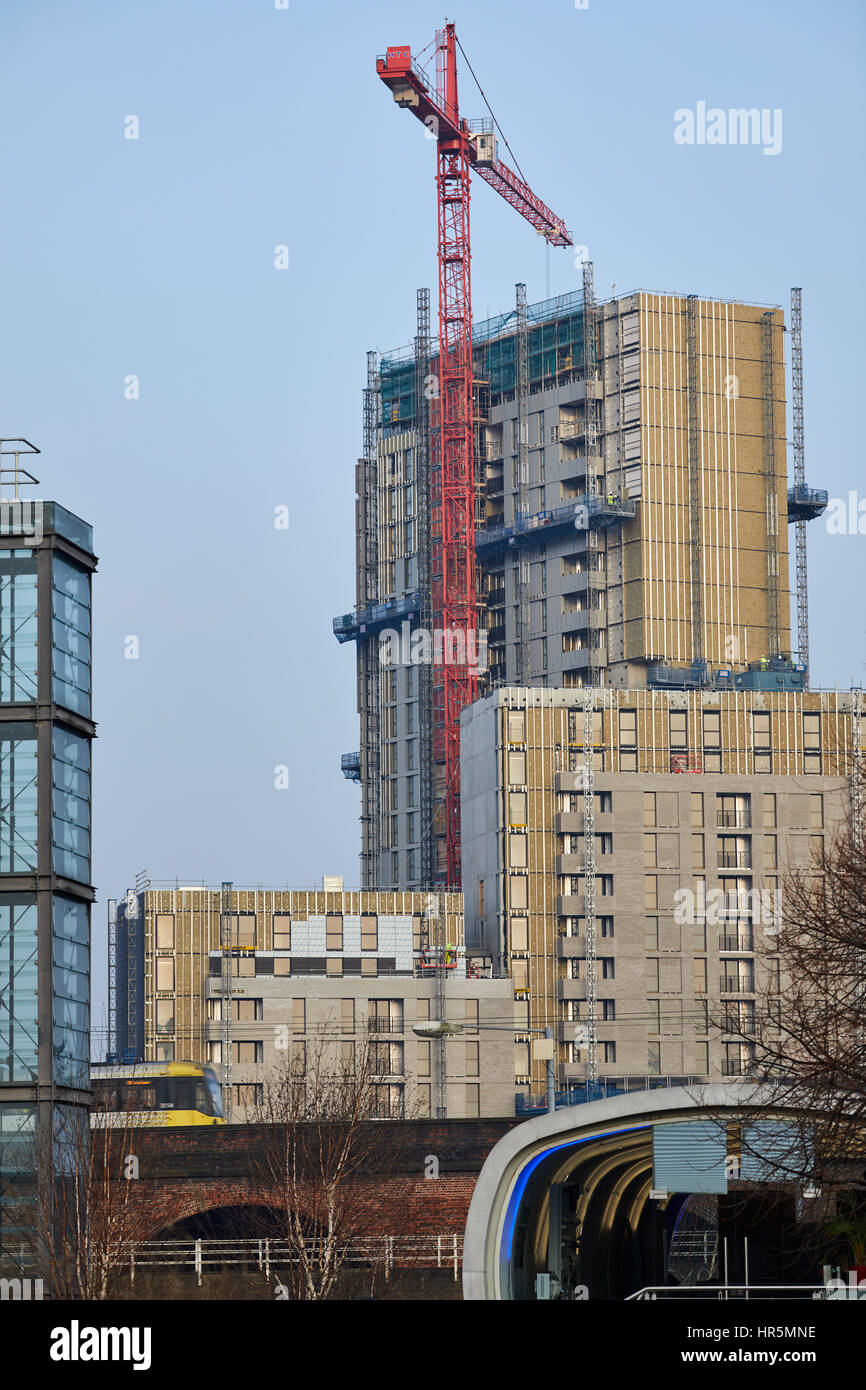 Blue sky sunny day tower cranes Castlefield Salford boundary Manchester skyline , England,UK - Stock Image