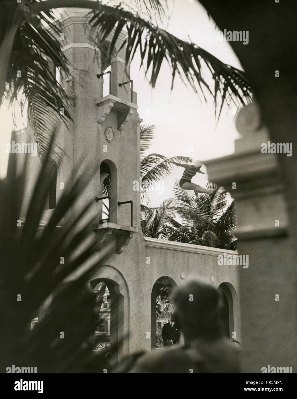 Olympic diving champion, Helen Meany, diving from the high-dive springboard into the pool at The Breakers resort - Stock Image