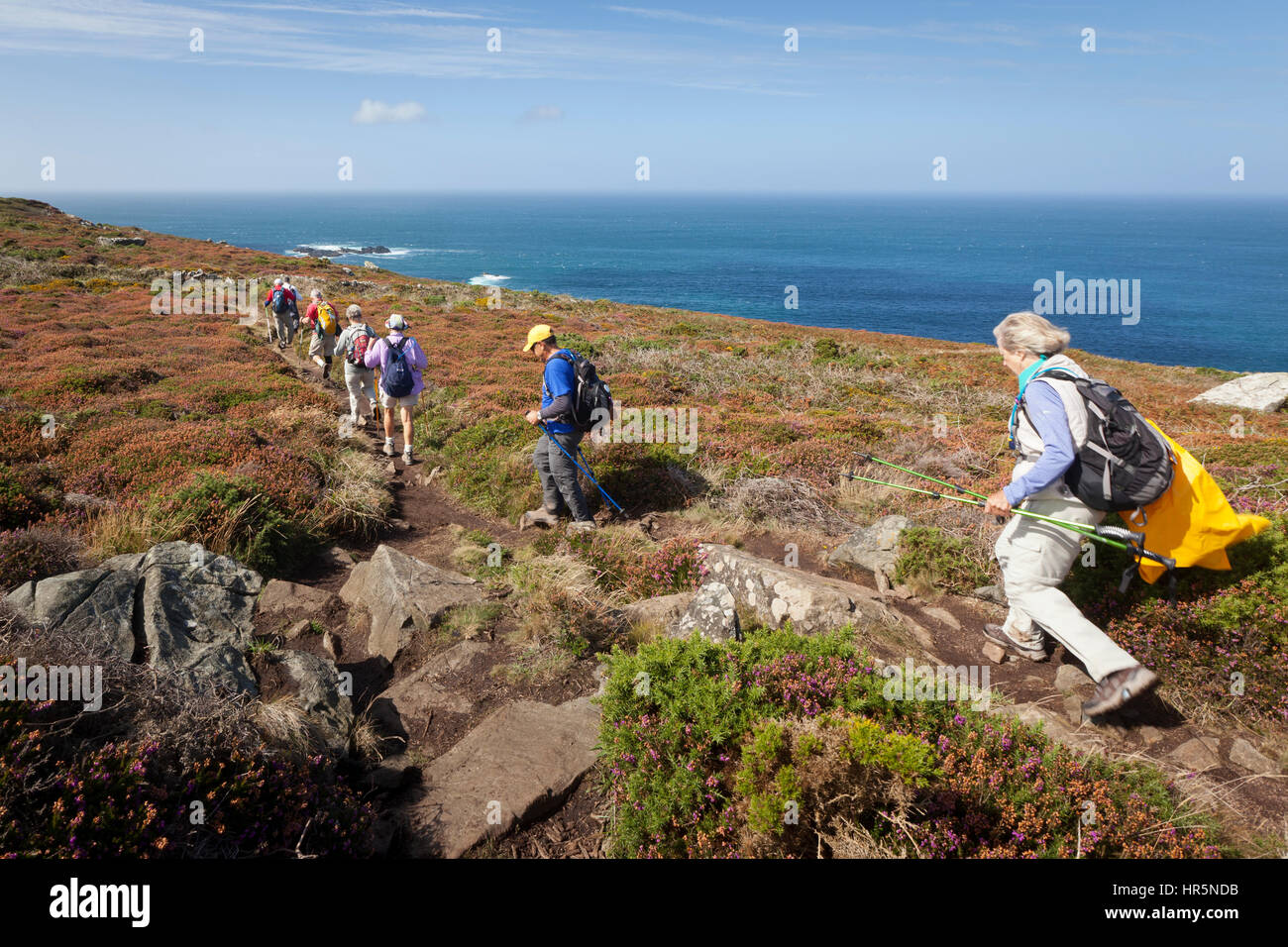 St Ives, United Kingdom - September 10, 2011: A group of adult ramblers walking the coastal path between St Ives - Stock Image