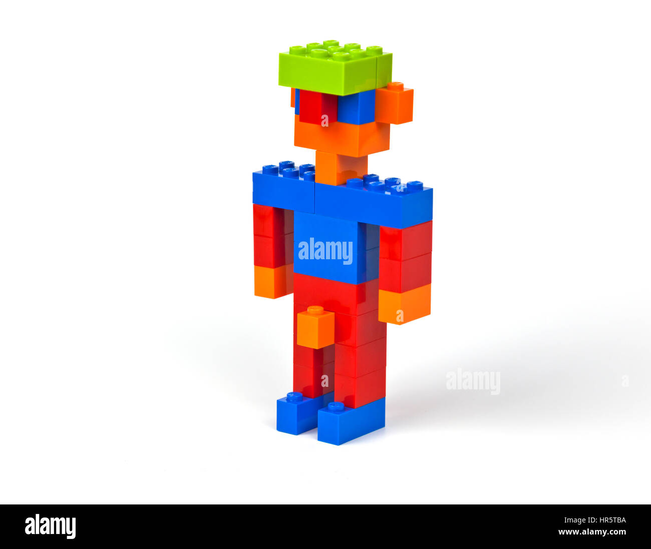 Slightly naughty happy male figure with jug-ears and a green cap constructed of Lego bricks - Stock Image