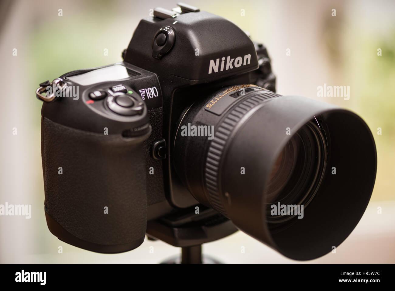Nikon F100 35mm SLR film camera, with Nikon 50mm f1.4G lens attached. - Stock Image