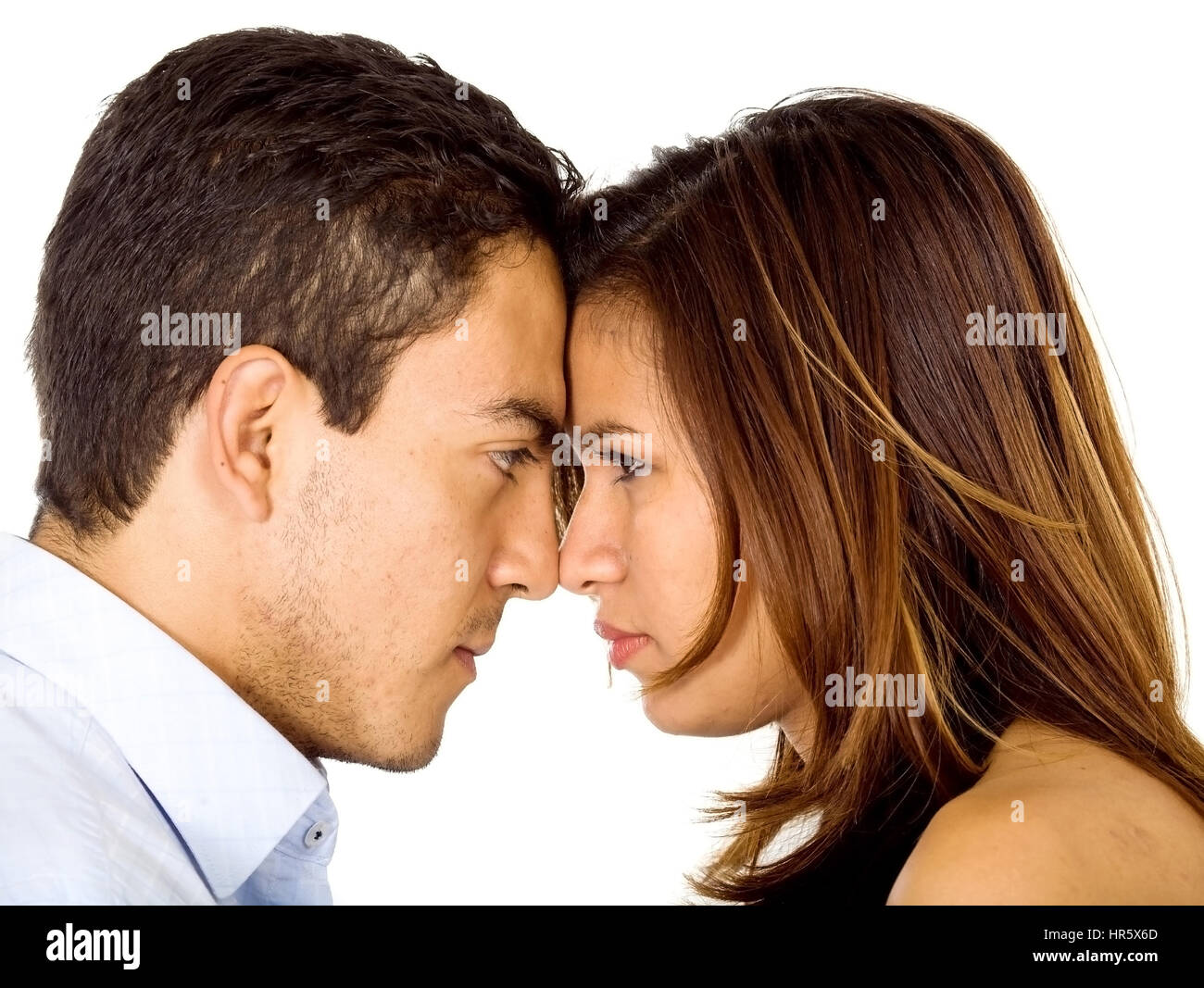 couple going head to head in an argument isolated over a white background - Stock Image