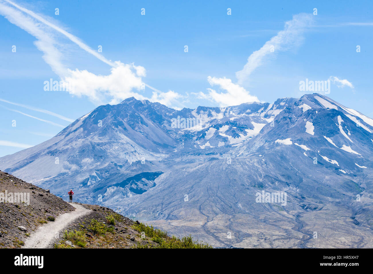 A woman hiker on the Johnston Ridge Trail, Mount St. Helens National Volcanic Monument, Washington, USA. - Stock Image