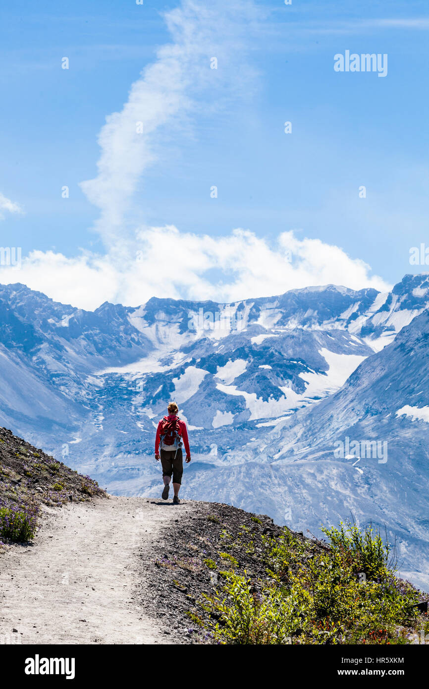 A woman hiker on the Johnston Ridge Trail, Mount St. Helens National Volcanic Monument - Stock Image
