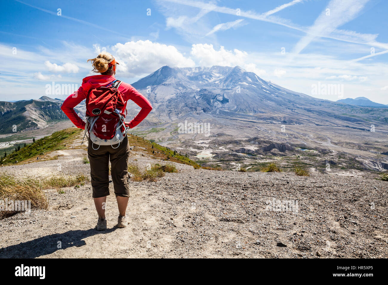 A woman hiking the Johnston Ridge  trail in Mount St Helens National Volcanic Monument, Washington, USA. - Stock Image
