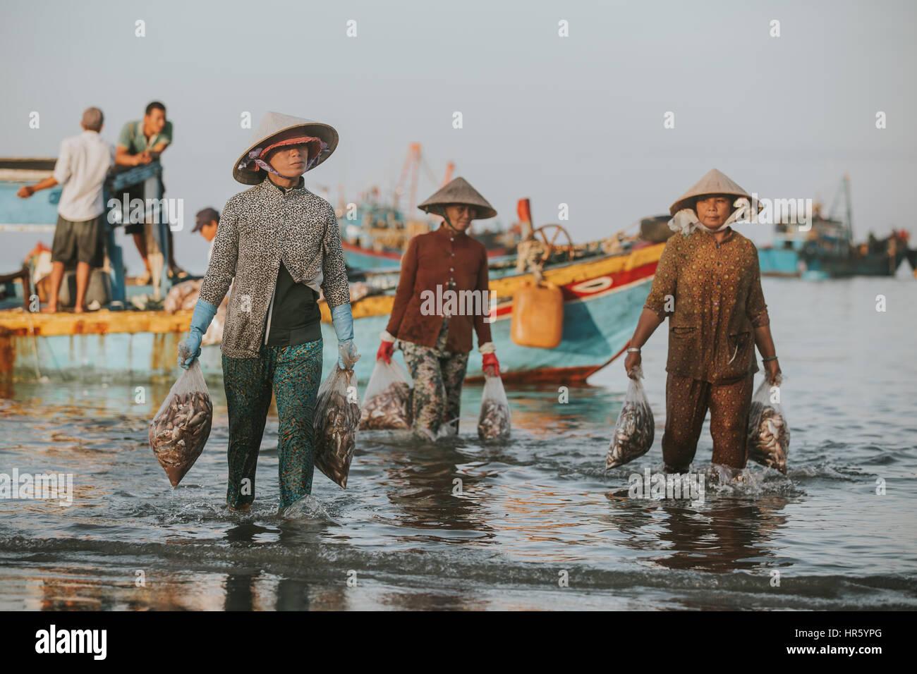 PHAN THIET, VIETNAM - November 9, 2016: Fishermen in Phan Thiet on November 9, 2016, Vietnam. Stock Photo