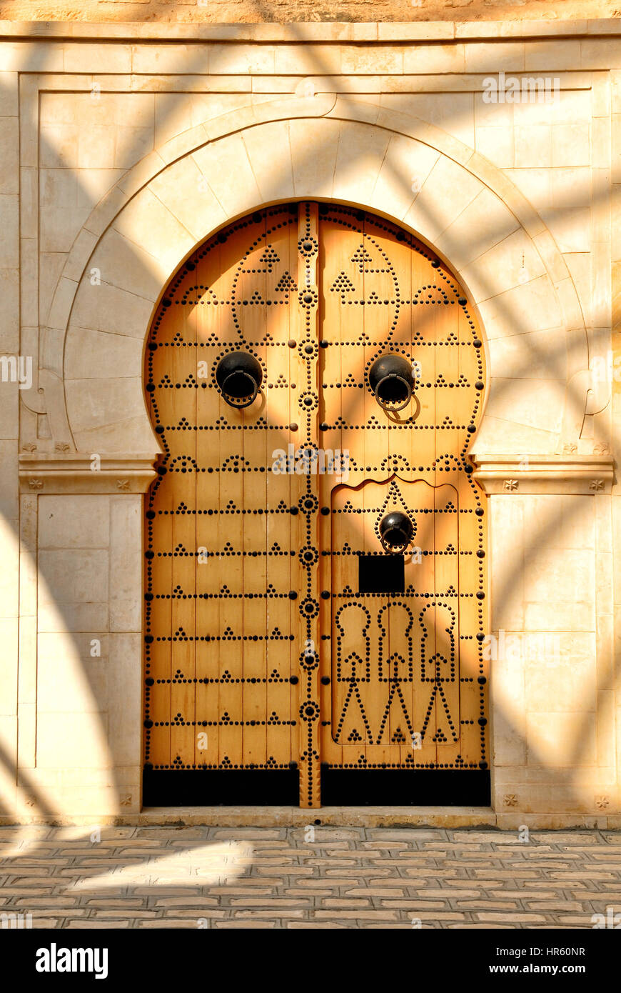 Traditional Tunisian door to a mosque Stock Photo