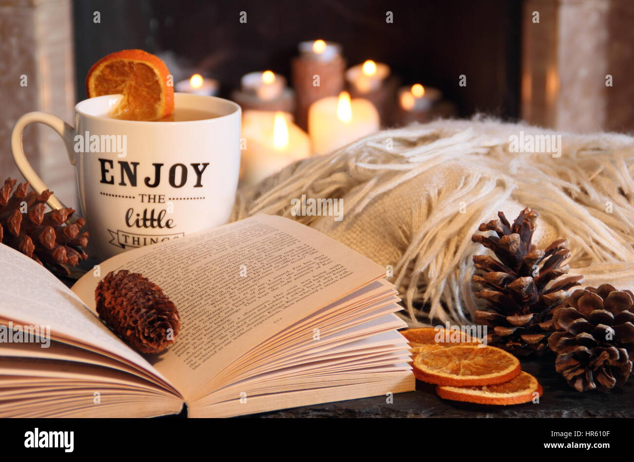 reading a paperback book by an open fire in a cosy hygge inspired stock photo 134742175 alamy. Black Bedroom Furniture Sets. Home Design Ideas