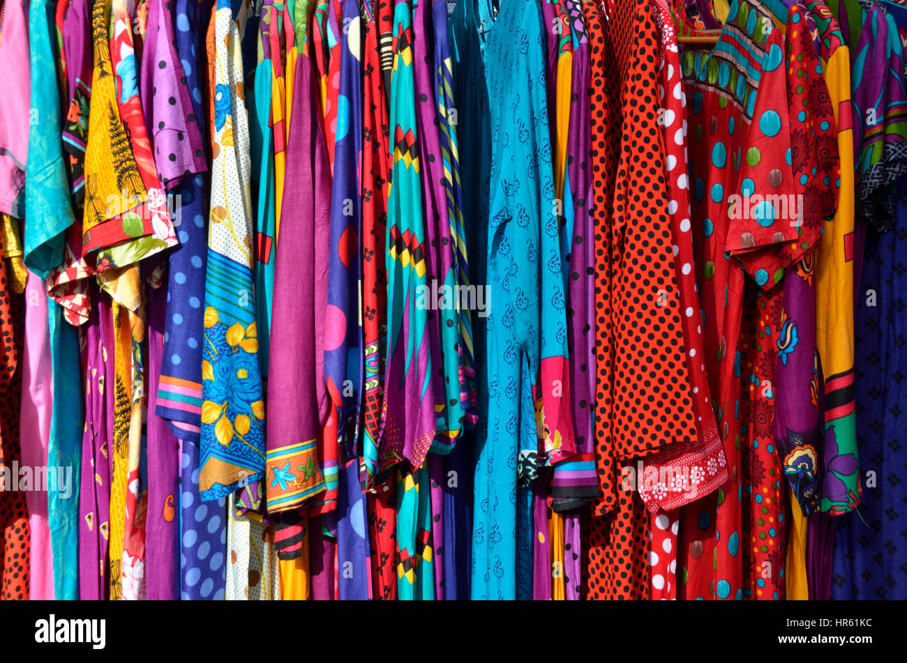 Indian sari dresses on display outside a shop. - Stock Image