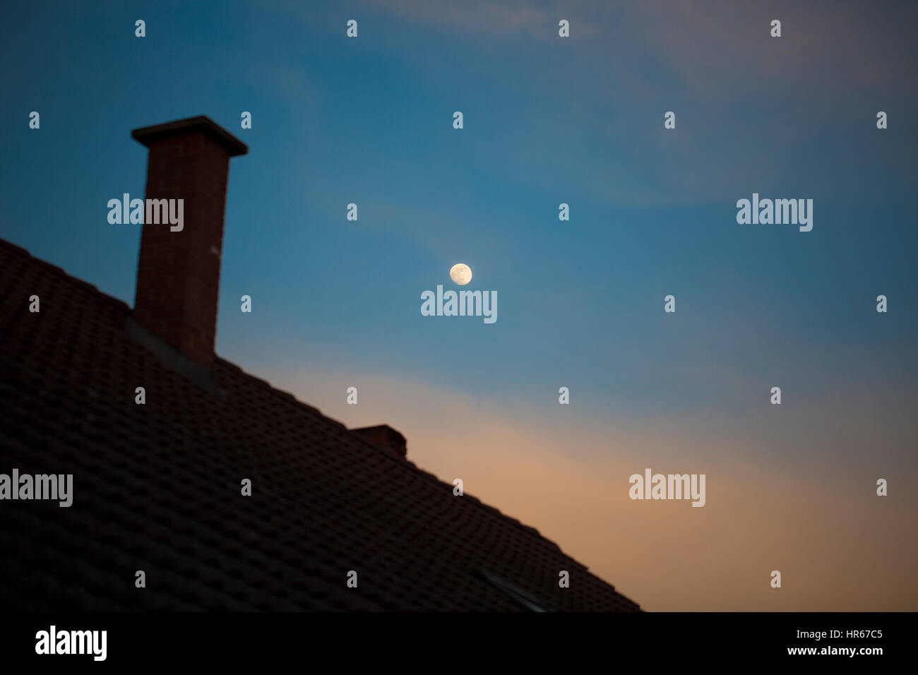 Moon over house - Stock Image