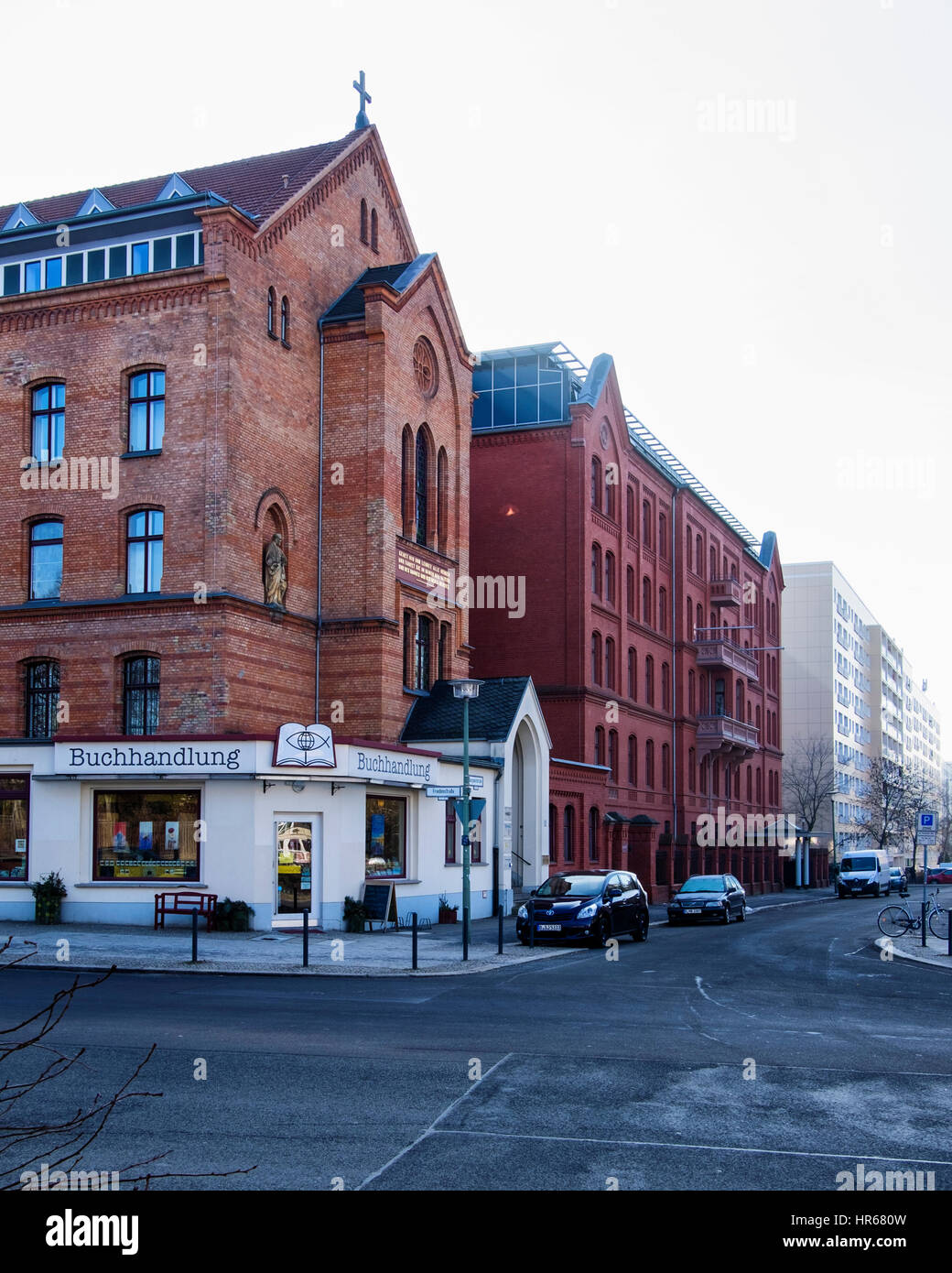 Berlin Friedrichshain. Religious book shop in old brick church building, Listed historic building exterior. - Stock Image