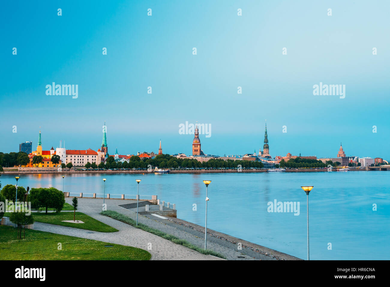Scenic View To Promenad Of Daugava, In Riga, Latvia. Old Church Towers And Castle On Background. Evening View With - Stock Image