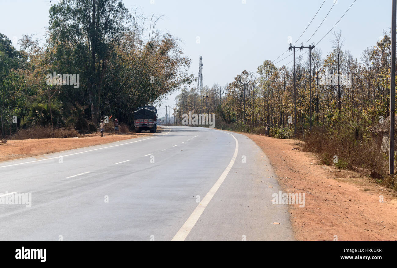 bankura, west bengal,India. February 25,2017. state highway surrounding with trees . - Stock Image