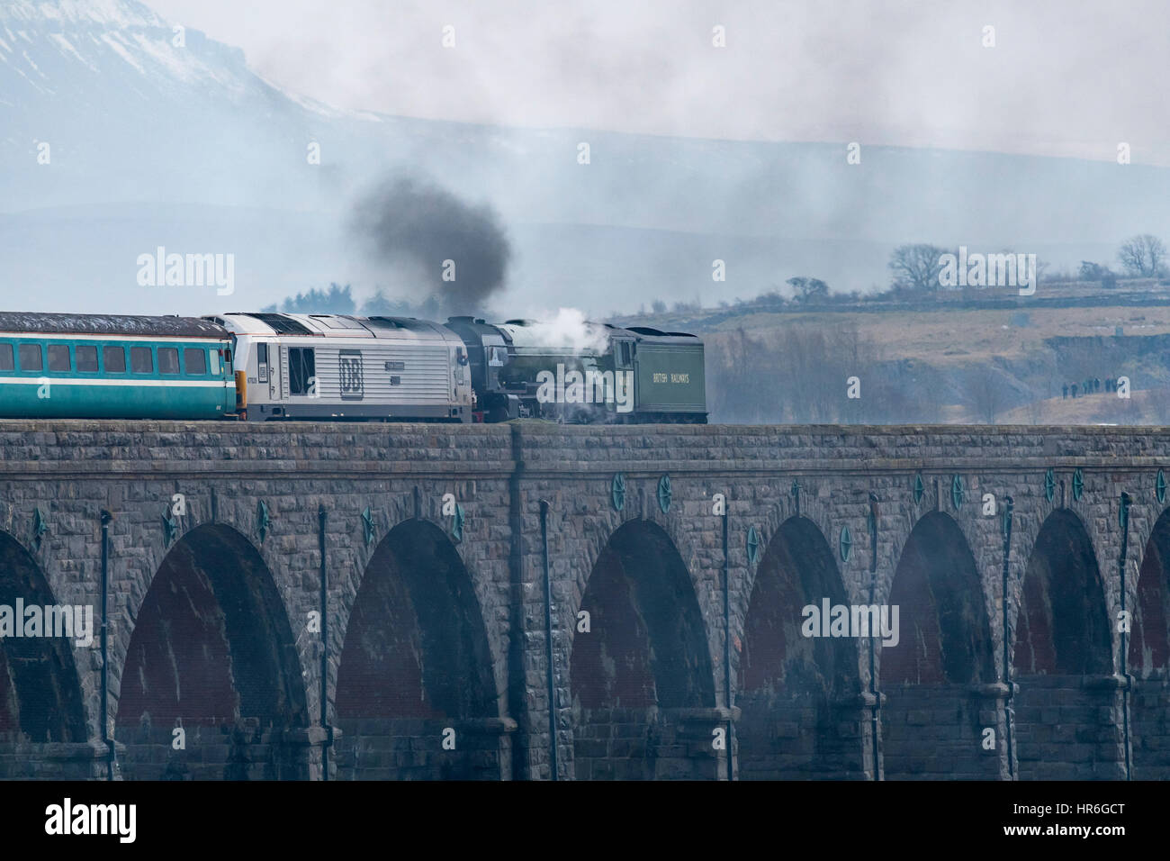 Locomotive, No. 60163 Tornado, a brand new Peppercorn A1 Pacific, travels across the Ribblehead Viaduct with snow - Stock Image