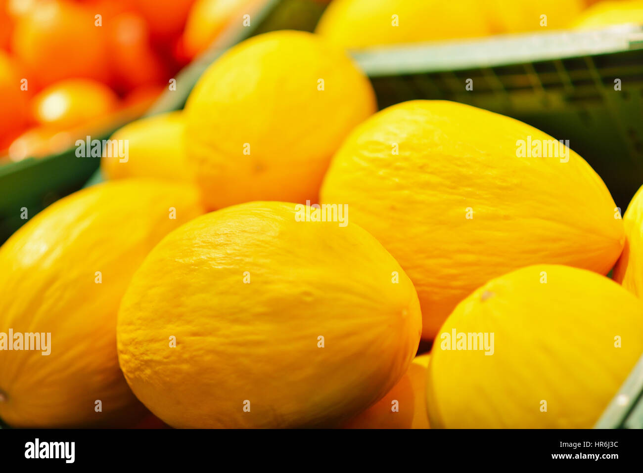 Fresh yellow melons displayed in a greengrocery. - Stock Image