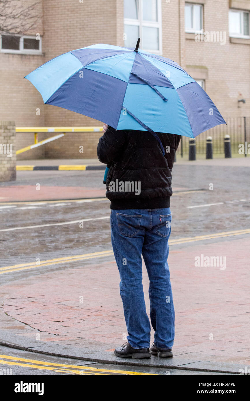 Southport, Merseyside, UK. 27th Feb, 2017. UK Weather. People venture into Southport town centre on a really wet Stock Photo