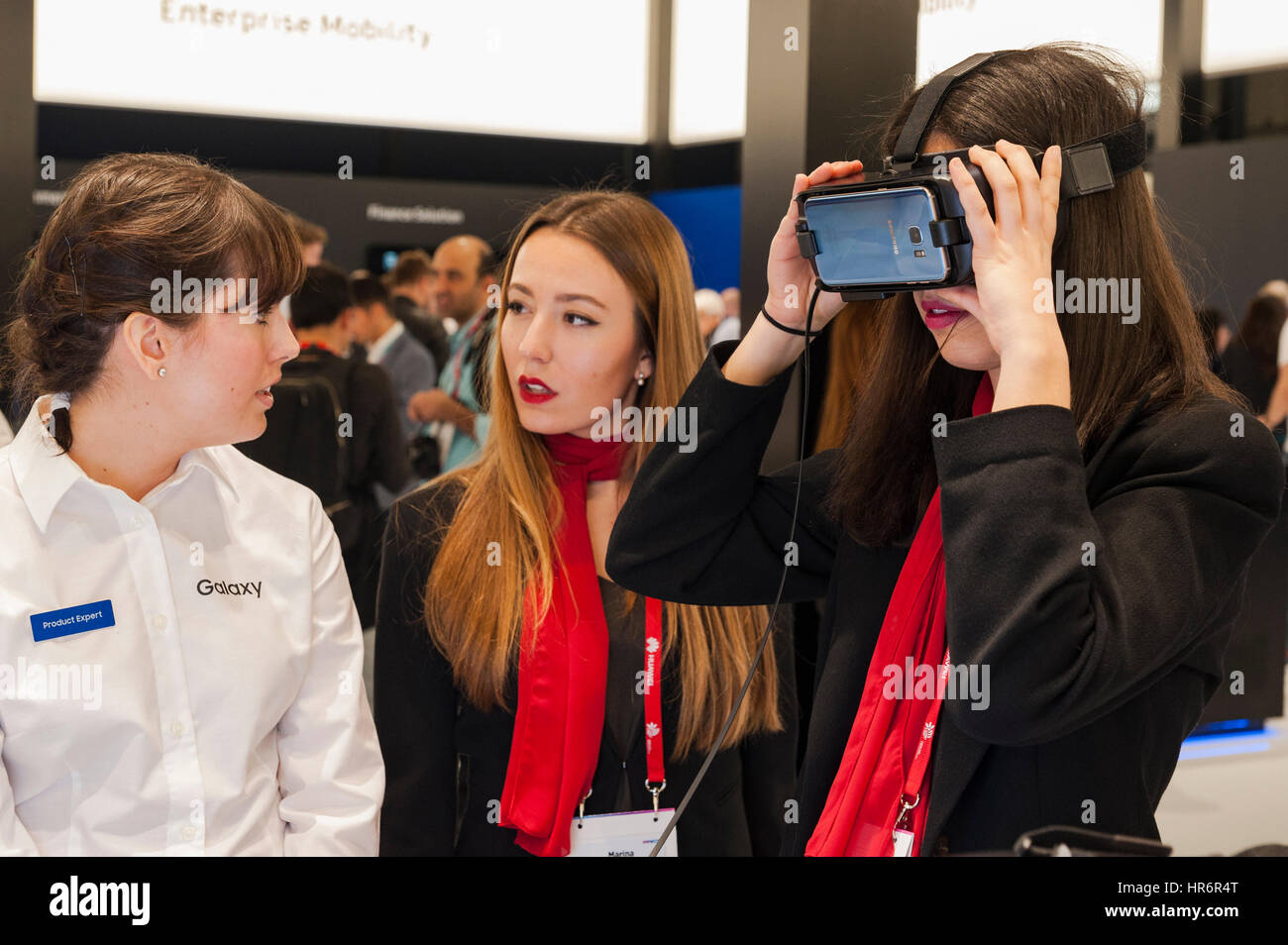 Barcelona, Spain. 27th Feb, 2017. A girl testing a Samsung Gear VR glasses during the Mobile World Congress wireless show in Barcelona. The annual Mobile World Congress hosts some of the world's largest communications companies, with many unveiling their latest phones and wearables gadgets. Credit: Charlie Perez/Alamy Live News Stock Photo