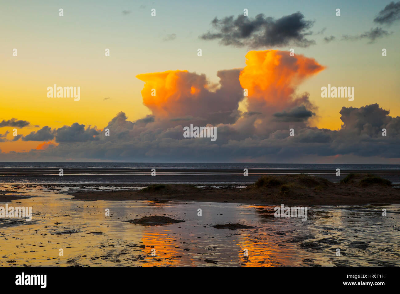 Southport, Merseyside, UK. 27th Feb, 2017. Weather. Sunset over Ainsdale Beach as orange towering Cumulus congestus - Stock Image