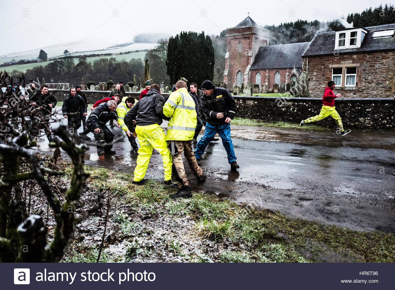Hobkirk, Hawick, Scottish Borders, UK. 27th Feb, 2017. Local men play the traditional annual hand ba' game in - Stock Image