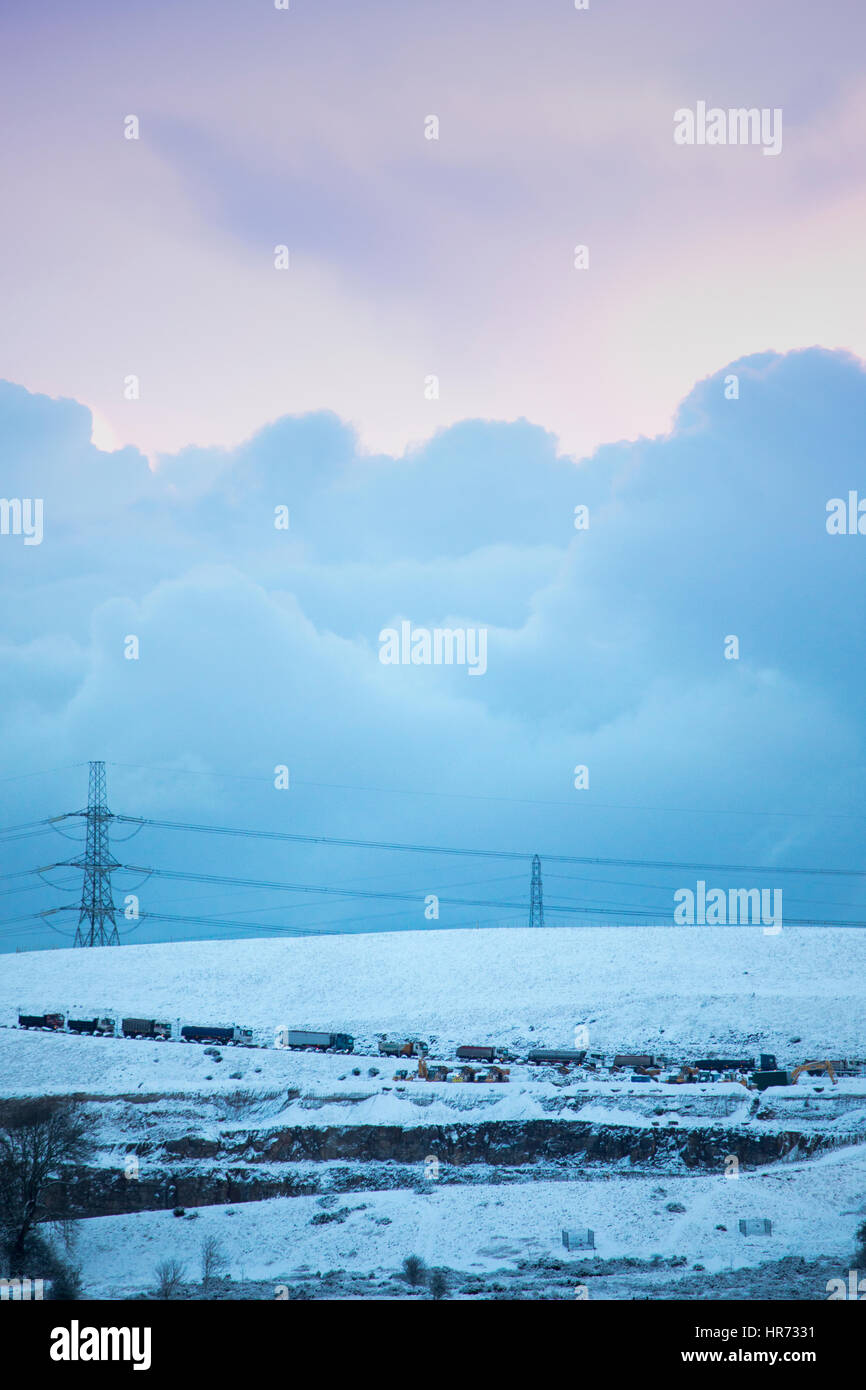 Snowed in lorries on an isolated rural road on Halkyn Mountain in Flintshire during a snow storm - Stock Image