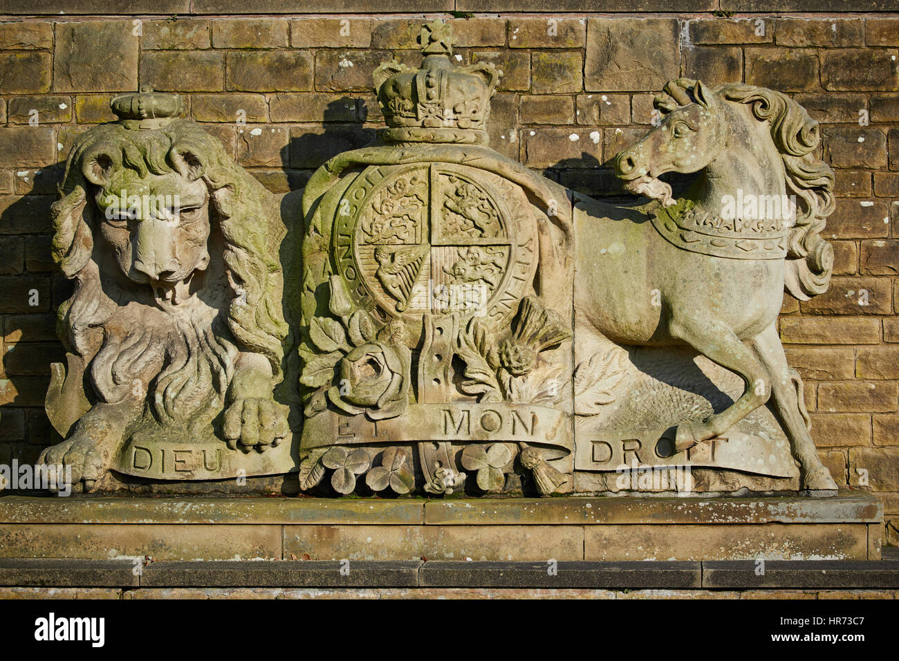 Sunny Preston Fulwood Barrack stone carved coat of arms large sandstone lion and horse in Lancashire, England,UK. - Stock Image