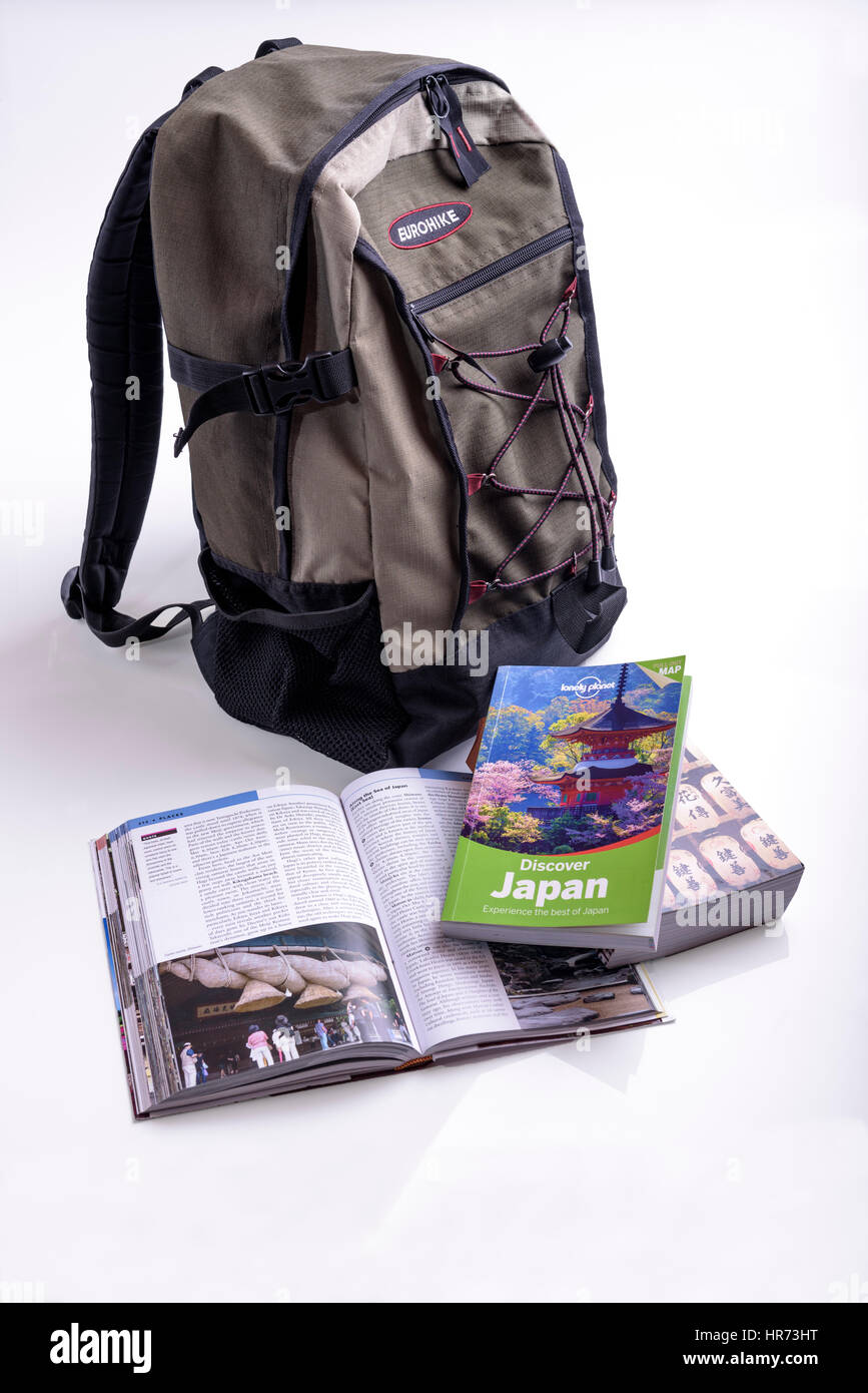 Backpack with travel guides. - Stock Image