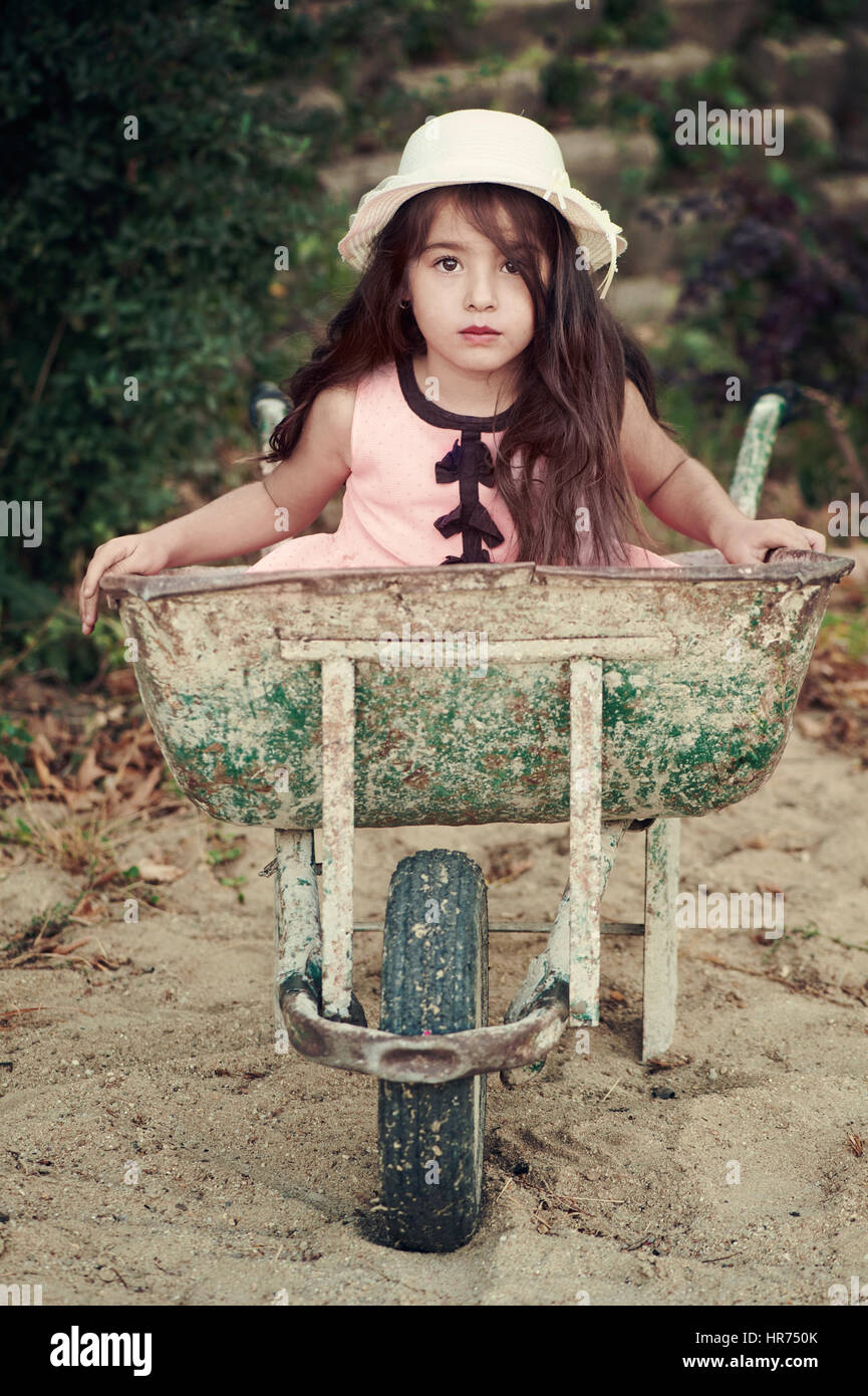 Little girl in wheelbarrow Stock Photo