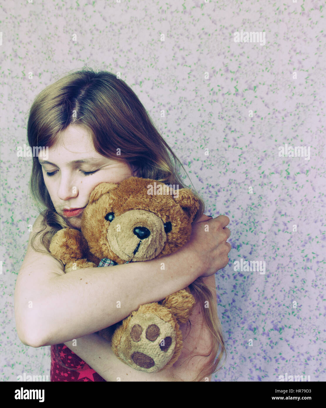 Someone with her teddy bear, like a child - Stock Image