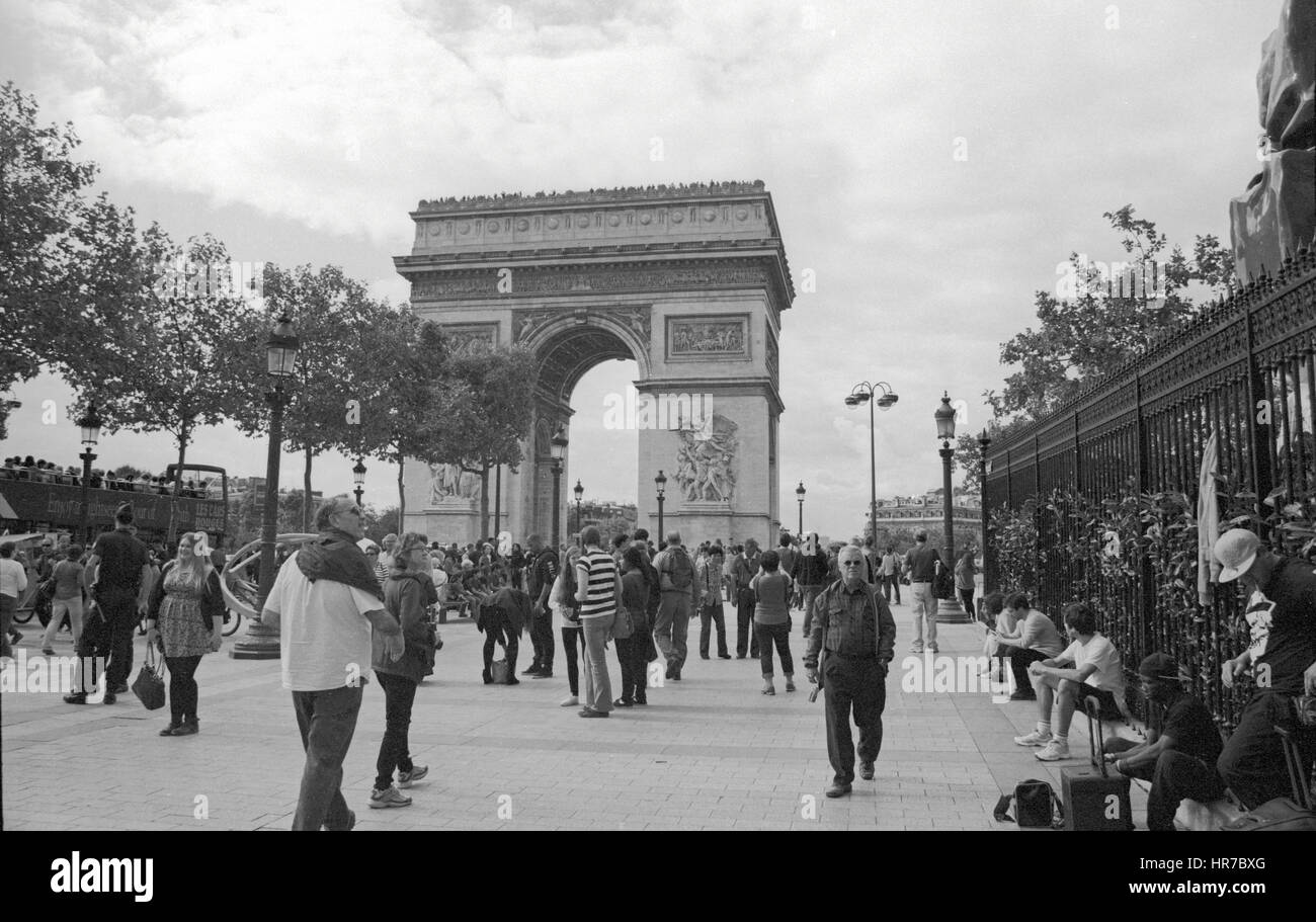 The Arc de Triomphe surrounded by tourists and Parisians. - Stock Image