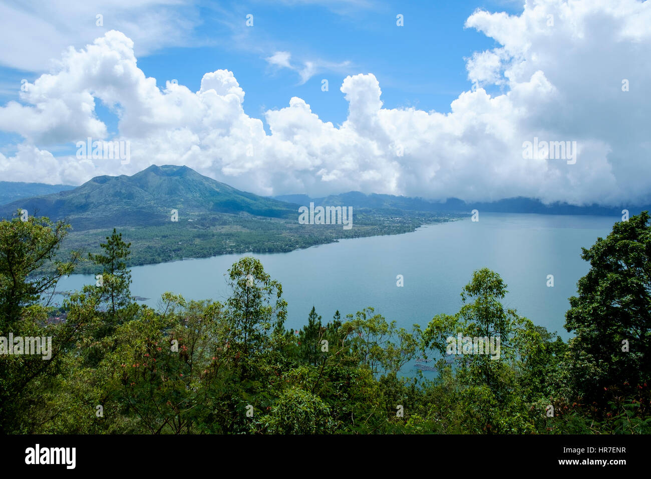 Lake Batur and Mount Batur (Gunung Batur), an active stratovolcano, seen from the Penelokan, KIntamani, Bali, Indonesia. - Stock Image