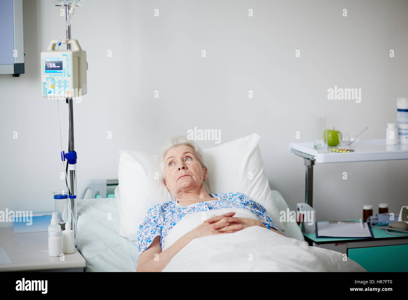 Sick Elderly Woman Resting In Hospital Bed After Getting