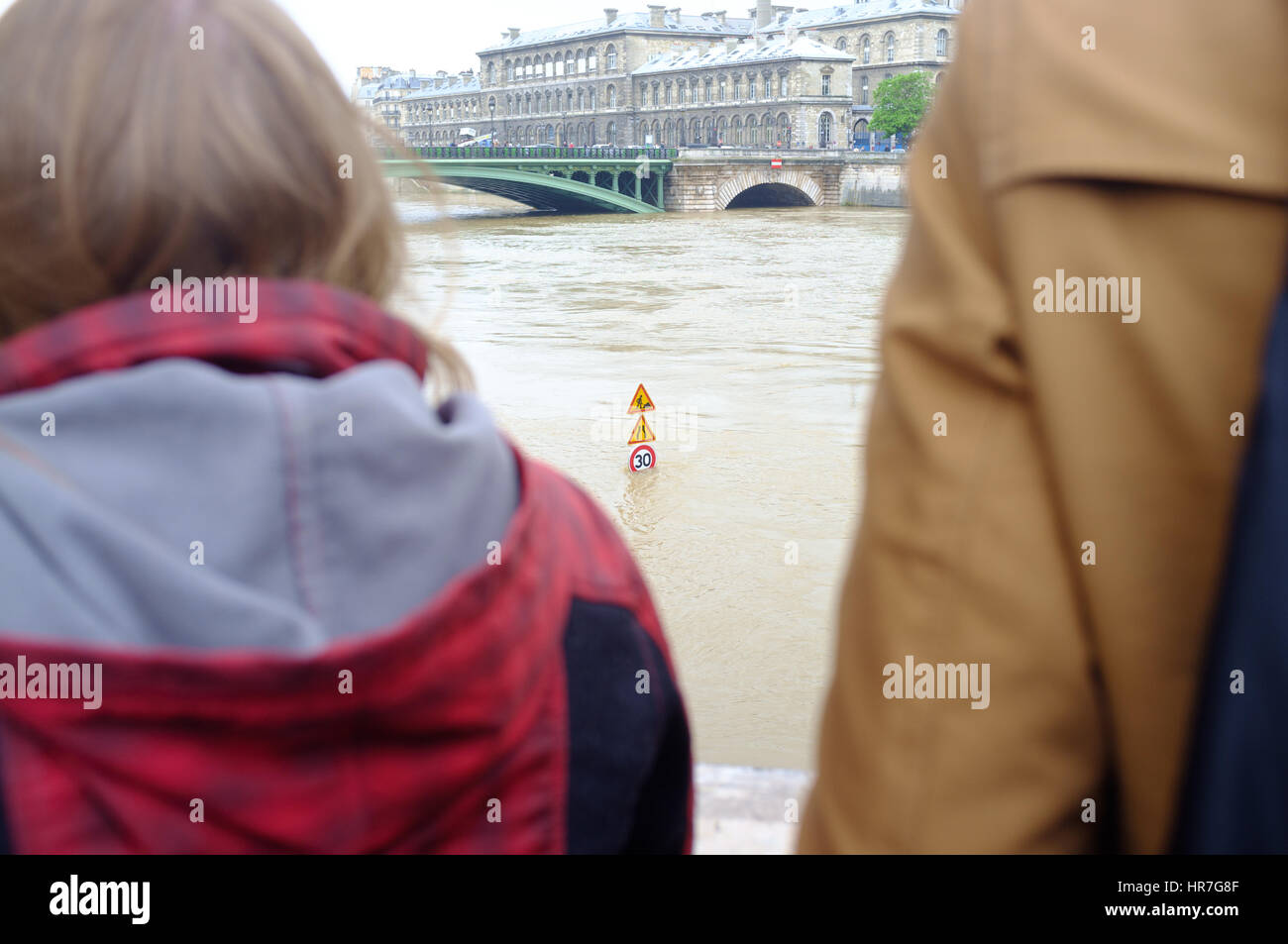 A couple looking at the flooding River Seine, Paris - Stock Image