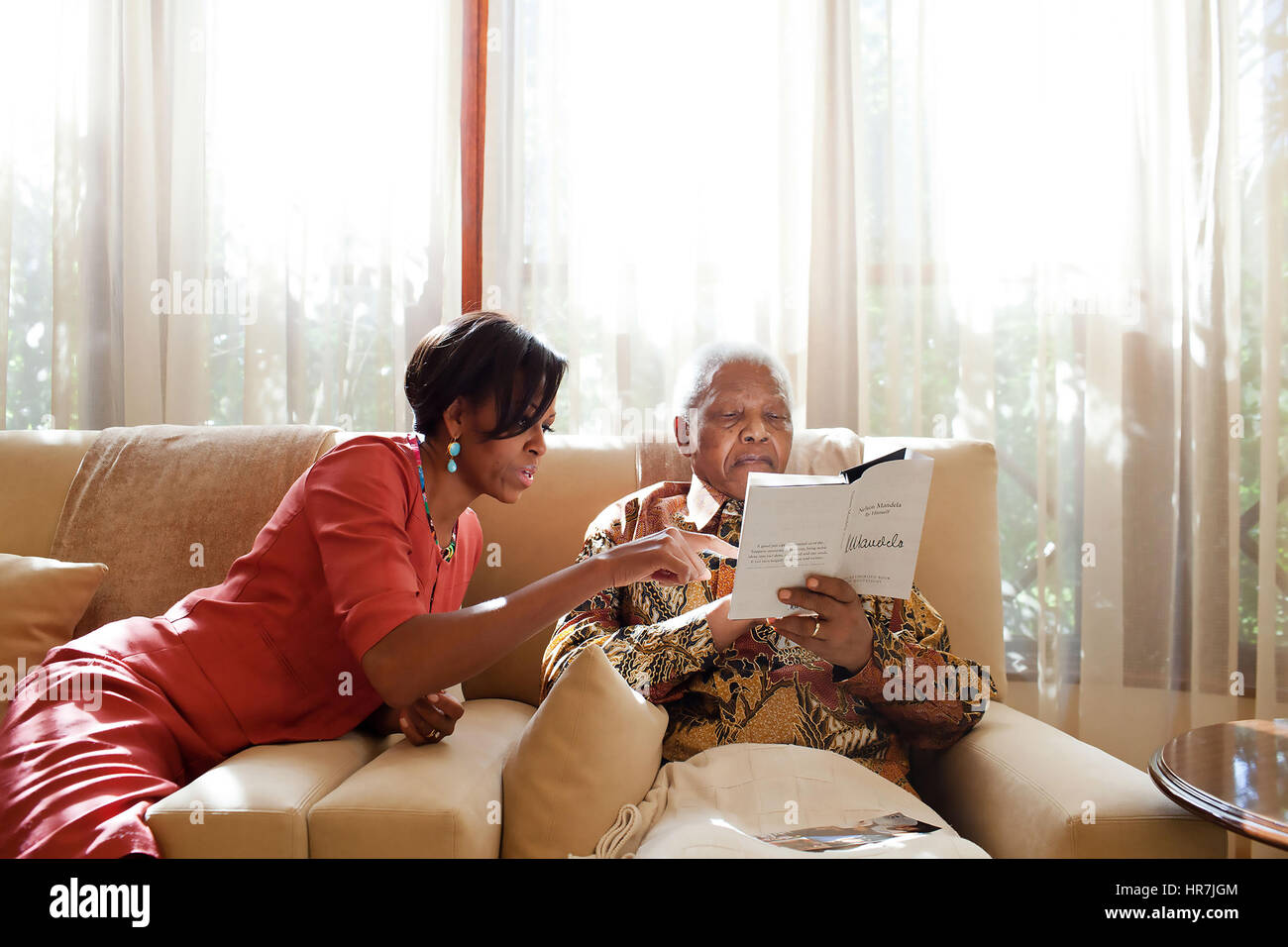 MICHELLE OBAMA  meets ex-South African President Nelson Mandela at his Johannesburg home on 21 June 2011. Photo: - Stock Image