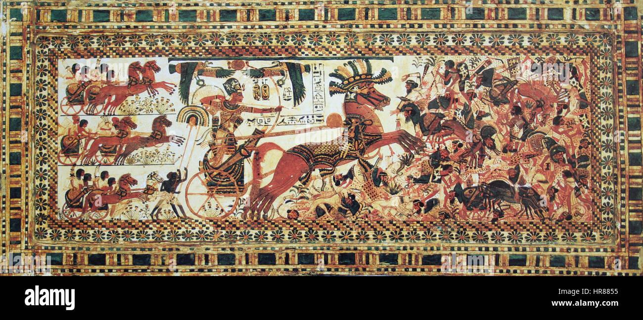 The Pharaoh Tutankhamun destroying his enemies - Stock Image