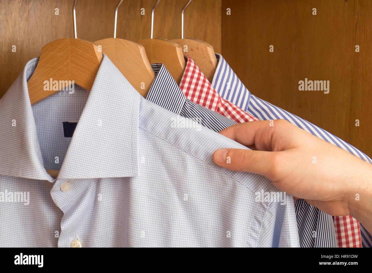 Shirts in several colors and textures - Stock Image