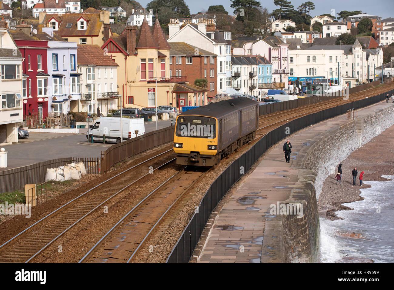Passenger train passing through the seaside town of Dawlish in South Devon England UK - Stock Image