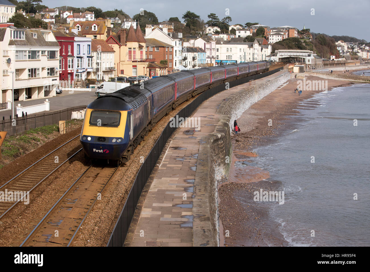 A Virgin Trains passenger train passing Dawlish a seaside resort in south Devon England UK - Stock Image
