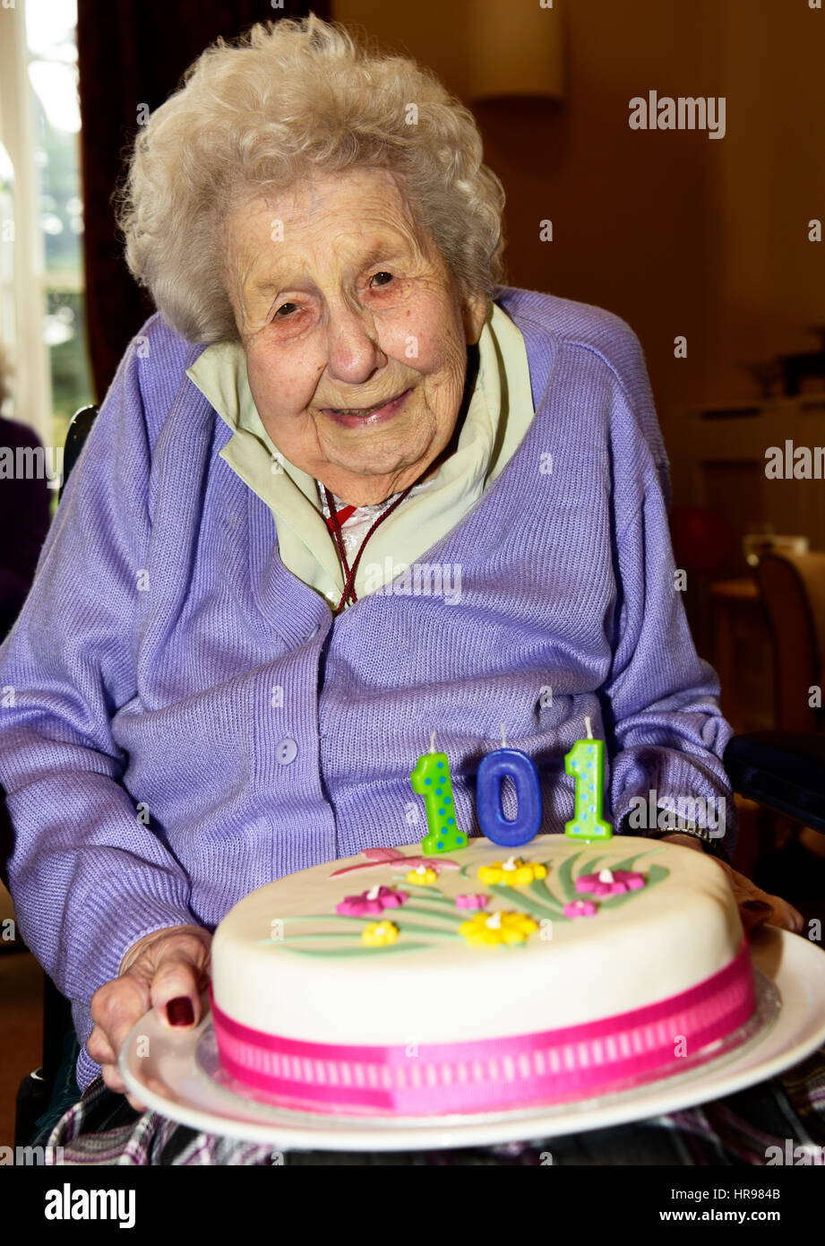 Elderly Woman In Wheelchair Holding Her Birthday Cake Celebrating 101 Years Residential Care