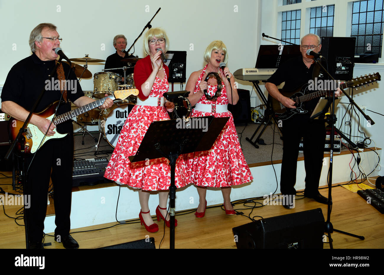 Local band - Out of the Shadows - performing popular songs from the 1960s at a community event organised by the - Stock Image