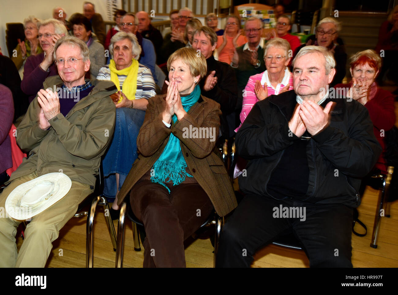 Audience members showing their appreciation for the 1960s music being performed at a community event organised by - Stock Image