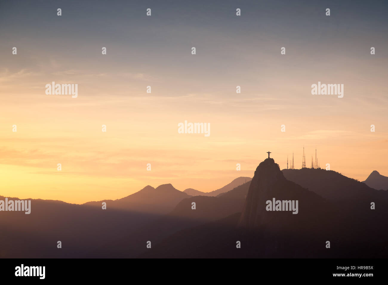 View of Christ Redeemer on Corcovado mountain from Sugar Loaf Mountain (Pao de Acucar) and Botafogo Bay at dusk, Stock Photo