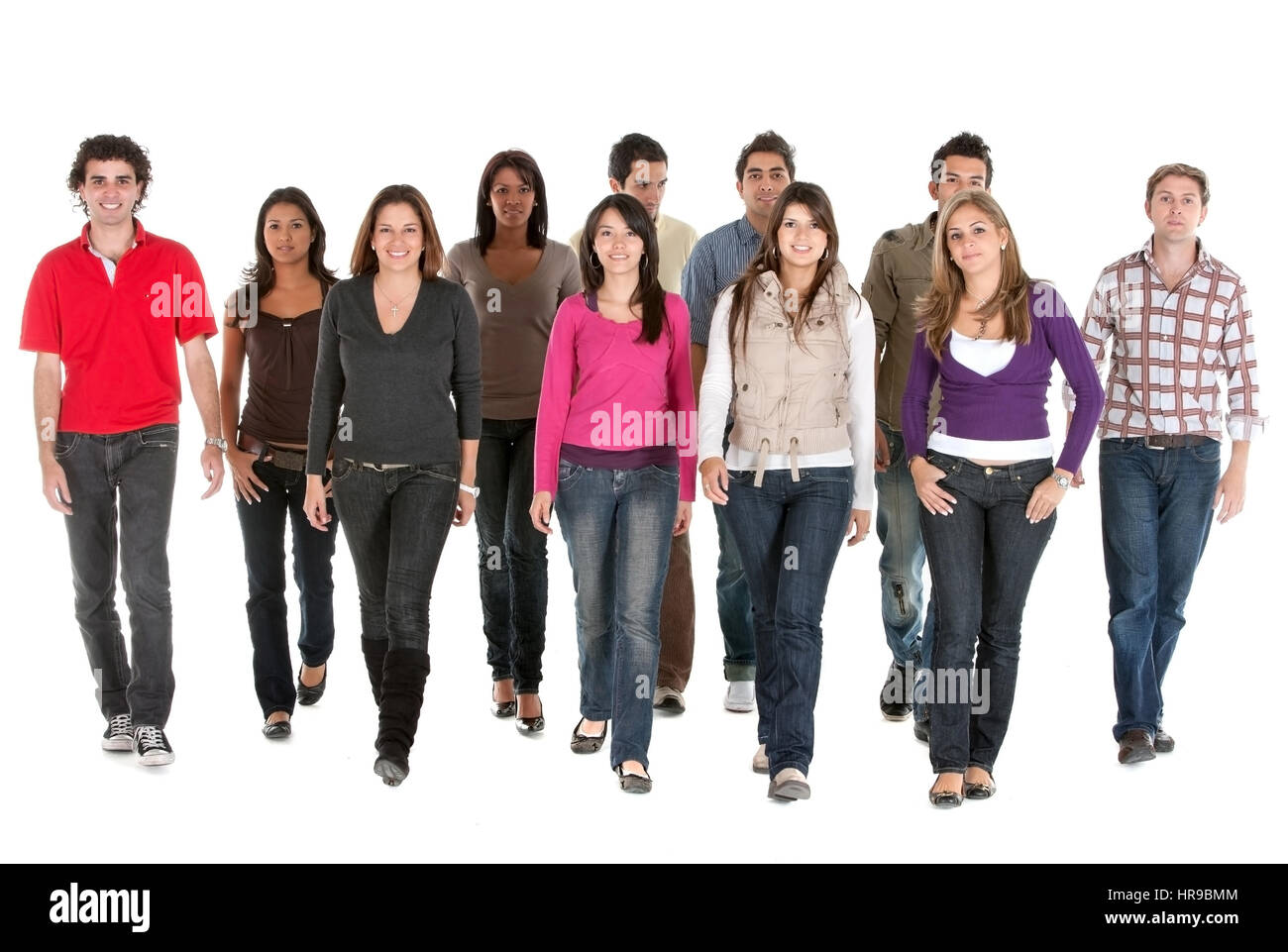 group of young people walking and smiling isolated over a white background - Stock Image